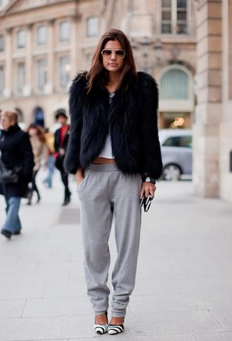 How to wear: black fur jacket, white cropped top, grey sweatpants, white and black leather pumps