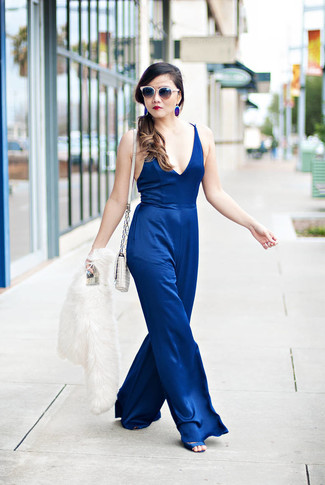 How to wear: white fur jacket, blue jumpsuit, blue satin heeled sandals, white quilted leather crossbody bag