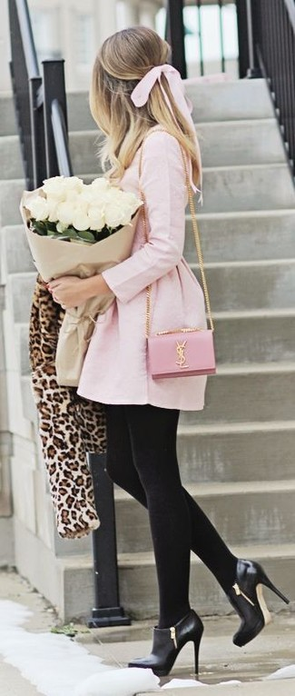 This combination of a cream leopard fur jacket and a pink skater dress is perfect for off-duty occasions. Round off this look with black leather ankle boots.