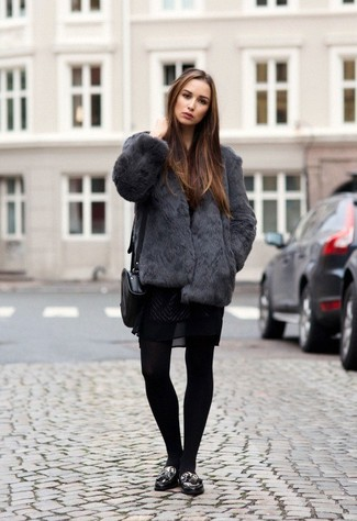 Black Leather Loafers Outfits For Women: For a tested relaxed casual option, you can always rely on this pairing of a charcoal fur jacket and a black lace skater dress. All you need now is a pair of black leather loafers to finish your ensemble.