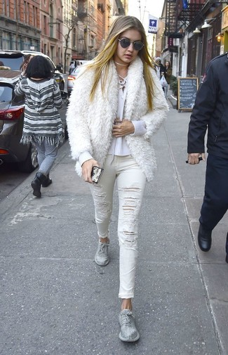 How to wear: white fur jacket, white v-neck sweater, white ripped skinny jeans, silver athletic shoes
