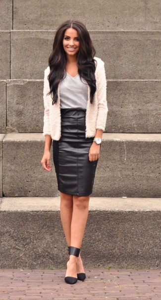 How to wear: white fur jacket, grey v-neck t-shirt, black leather pencil skirt, black leather pumps