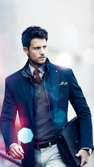How to wear: navy gilet, navy blazer, charcoal mock-neck sweater, white and blue gingham dress shirt
