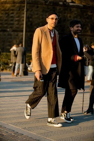 Black and White Leather Low Top Sneakers Outfits For Men: This combo of a red gilet and dark brown vertical striped chinos is hard proof that a straightforward casual getup doesn't have to be boring. We love how a pair of black and white leather low top sneakers makes this look whole.