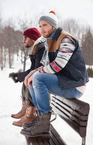 How to Wear a Navy Gilet For Men: We're all hunting for functionality when it comes to style, and this casual street style combination of a navy gilet and blue ripped jeans is a practical illustration of that. Tone down the casualness of your ensemble with a pair of dark brown leather casual boots.