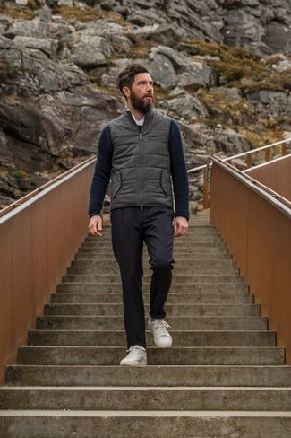 Sweater Outfits For Men: A sweater and navy vertical striped chinos are the ideal way to infuse muted dapperness into your day-to-day casual routine. For something more on the dressier end to complete this getup, complement your look with white canvas low top sneakers.