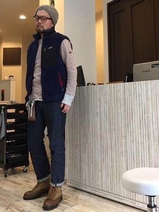 How to wear: navy fleece gilet, beige crew-neck sweater, grey long sleeve t-shirt, navy jeans