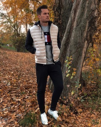 Gilet Outfits For Men: A gilet and a grey print crew-neck t-shirt are the kind of a tested casual getup that you so terribly need when you have zero time. If not sure about the footwear, complete this outfit with white leather low top sneakers.