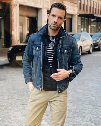 How to wear: navy quilted gilet, navy denim jacket, navy and white horizontal striped crew-neck sweater, khaki chinos