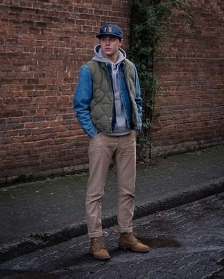 Olive Quilted Gilet Outfits For Men: Pair an olive quilted gilet with khaki chinos for a casual and cool and fashionable look. If you wish to immediately up the ante of this look with shoes, complement this ensemble with a pair of brown suede casual boots.