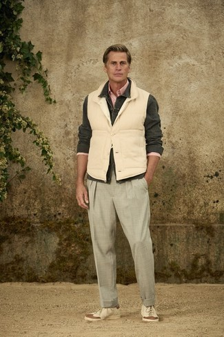 Grey Chinos Outfits: This ensemble with a beige gilet and grey chinos isn't hard to pull off and is easy to adapt. Bring an easy-going vibe to this getup with beige leather low top sneakers.
