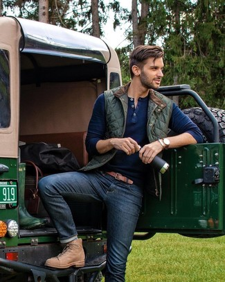 How to wear: dark green quilted gilet, navy henley sweater, navy jeans, tan leather casual boots
