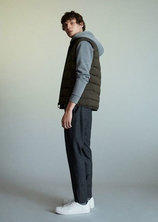 Olive Quilted Gilet Spring Outfits For Men: An olive quilted gilet and charcoal chinos have become an essential combination for many fashionable men. White canvas low top sneakers are a good pick to round off your ensemble. So if you're looking for an ensemble that's seriously stylish but also totally season-appropriate, you found it.