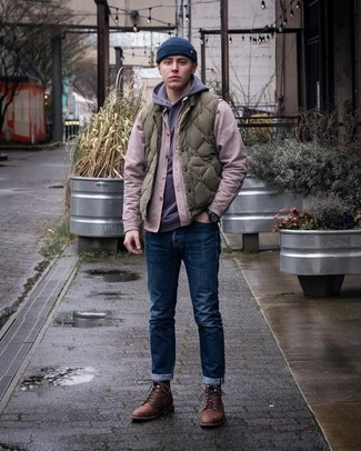 Olive Quilted Gilet Chill Weather Outfits For Men: If you feel more confident wearing something practical, you'll appreciate this off-duty combination of an olive quilted gilet and navy jeans. For a sleeker take, add brown leather casual boots.