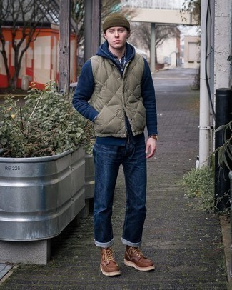 Olive Quilted Gilet Chill Weather Outfits For Men: An olive quilted gilet and navy jeans are indispensable menswear pieces, without which no wardrobe would be complete. Feeling transgressive? Change things up a bit with brown leather casual boots.