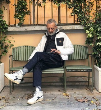 Grey Hoodie Outfits For Men After 50: For a look that provides function and dapperness, pair a grey hoodie with navy print chinos. Feel uninspired with this outfit? Let white and navy leather high top sneakers mix things up. If you're not sure how to dress your age, this combo is a real lifesaver.