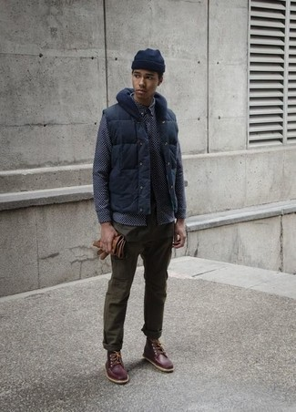 How to wear: navy gilet, navy print long sleeve shirt, olive chinos, dark brown leather work boots