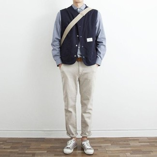 How to Wear a Navy Gilet For Men: A navy gilet and beige chinos are the kind of a foolproof off-duty look that you so terribly need when you have no extra time. For something more on the daring side to finish this outfit, introduce grey canvas low top sneakers to the mix.