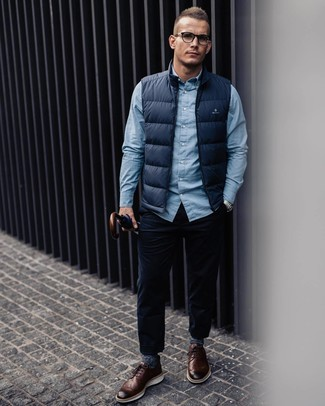 How to wear: navy gilet, light blue long sleeve shirt, navy corduroy jeans, brown leather brogues