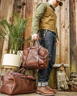 Olive Long Sleeve Shirt Outfits For Men: Stand out among other dudes in an olive long sleeve shirt and navy jeans. With footwear, go for something on the smarter end of the spectrum and finish this outfit with brown leather casual boots.