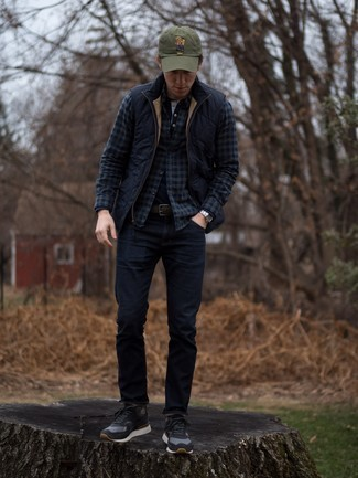 How to Wear a Baseball Cap For Men: Consider teaming a navy quilted gilet with a baseball cap to create an interesting and modern-looking street style ensemble. Want to dress it up in the footwear department? Rock a pair of black suede low top sneakers.