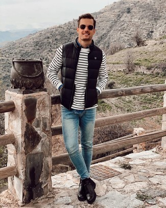 Gilet Outfits For Men: A gilet and blue skinny jeans teamed together are a perfect match. Go ahead and rock a pair of black leather chelsea boots for a dose of elegance.