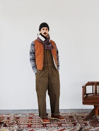 Scarf Outfits For Men: Who said you can't make a fashion statement with an edgy ensemble? You can do so with ease in an orange quilted gilet and a scarf. Complement this look with tobacco leather casual boots to effortlessly kick up the style factor of this ensemble.