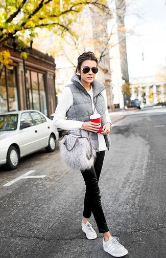 How to wear: grey quilted gilet, white long sleeve t-shirt, black chinos, grey low top sneakers