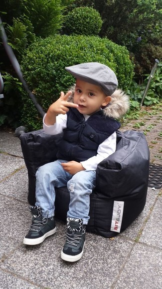 Boys' Looks & Outfits: What To Wear In Spring: Suggest that your little guy choose a navy gilet and light blue jeans for a fun day in the park. Complement this ensemble with black leather sneakers.