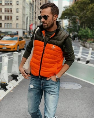 How to wear: orange quilted gilet, charcoal long sleeve t-shirt, blue ripped jeans, beige canvas tote bag