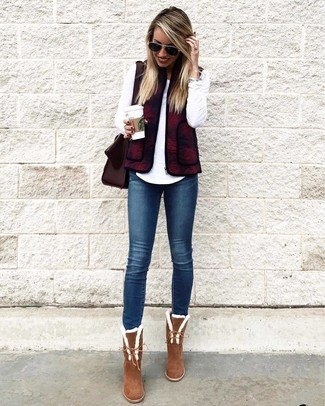 If you're a fan of relaxed dressing when it comes to fashion, you'll love this cute combination of a gilet and navy skinny jeans. Go for a pair of brown suede ankle boots to instantly up the chic factor of any outfit. This one will play especially well when spring arrives.