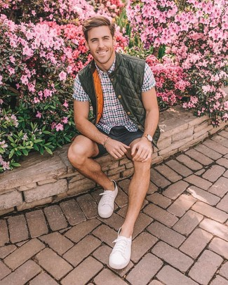 How to wear: olive quilted gilet, multi colored check short sleeve shirt, charcoal shorts, white canvas low top sneakers