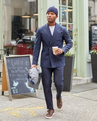 Suit Outfits: When it comes to timeless refinement, this pairing of a suit and a grey quilted gilet doesn't disappoint. And if you need to instantly play down your look with shoes, complete your look with brown suede low top sneakers.