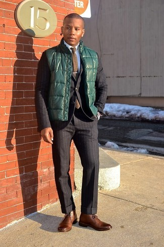 How to wear: dark green gilet, black vertical striped suit, white dress shirt, brown leather desert boots