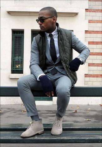 How to wear: dark green gilet, grey suit, white dress shirt, beige suede desert boots