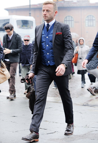 How to Wear a Charcoal Suit: Opt for a charcoal suit and a blue gilet - this look will certainly make an entrance. The whole look comes together when you round off with a pair of dark brown leather brogues.