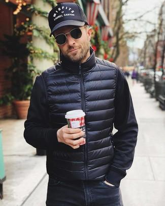 How to wear: black gilet, black sweatshirt, black jeans, black and white print baseball cap