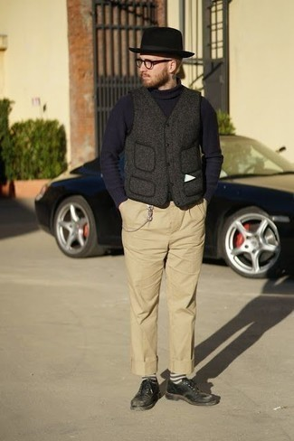 Men's Looks & Outfits: What To Wear In 2020: This pairing of a charcoal wool gilet and khaki chinos is the ultimate relaxed getup for any modern guy. Stick to a classier route in the shoe department by slipping into a pair of black leather derby shoes.