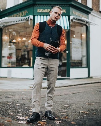 Navy Quilted Gilet Outfits For Men: We love the way this pairing of a navy quilted gilet and grey wool dress pants immediately makes a man look sharp and refined. A great pair of black leather casual boots is the simplest way to inject a sense of stylish casualness into your getup.