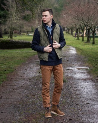 Light Blue Chambray Long Sleeve Shirt Outfits For Men: If you don't like spending too much time on your outfits, dress in a light blue chambray long sleeve shirt and tobacco chinos. Complete your look with a pair of brown leather casual boots for a touch of refinement.