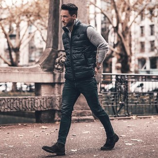 How to Wear Black Suede Dress Boots For Men: This combination of a black gilet and navy skinny jeans is super easy to do and so comfortable to rock as well! Play down the casualness of this look by wearing a pair of black suede dress boots.