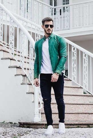 How to wear: green leather bomber jacket, white crew-neck t-shirt, navy ripped jeans, white low top sneakers