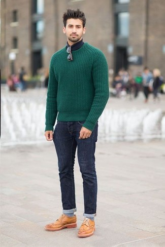 Reach for a green cable pullover and navy jeans to effortlessly deal with whatever this day throws at you. A pair of tan leather brogues will bring a strong and masculine feel to any ensemble.