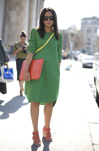 Make a green wool casual dress your outfit choice for a casual-cool vibe. Elevate this ensemble with pale pink leather wedge sandals.