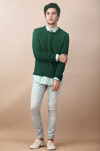 How to wear: green crew-neck sweater, mint dress shirt, light blue jeans, beige canvas low top sneakers