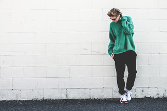 How to wear: green knit oversized sweater, black sweatpants, white and black athletic shoes