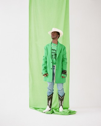 How to wear: green overcoat, green print sweatshirt, light blue jeans, black and white leather cowboy boots