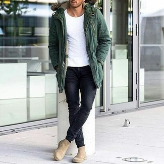 A parka and black slim jeans are your go-to outfit for lazy days. Elevate this ensemble with beige suede chelsea boots.