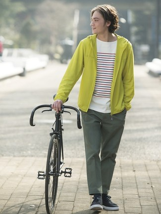 How to wear: green-yellow windbreaker, white horizontal striped crew-neck t-shirt, dark green chinos, black low top sneakers