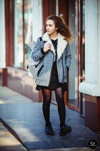 How to wear: grey biker jacket, black shift dress, black studded leather oxford shoes, white and black polka dot backpack